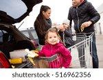 Parents Pushing Shopping Cart...
