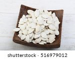 pumpkin seeds in the bowl on... | Shutterstock . vector #516979012