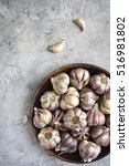 garlic in a clay bowl  on a...   Shutterstock . vector #516981802