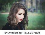 lovely girl in the park. pretty ... | Shutterstock . vector #516987805