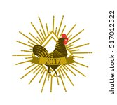 rooster with sunburst .... | Shutterstock .eps vector #517012522