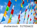buddhist praying flags at mati... | Shutterstock . vector #517026622