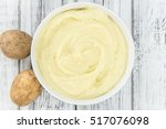 portion of homemade mashed... | Shutterstock . vector #517076098