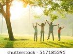asian family walking outdoor in ... | Shutterstock . vector #517185295