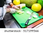 slicing melons and other fruit... | Shutterstock . vector #517199566