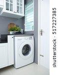 washing machine in a kitchen... | Shutterstock . vector #517227385