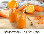 jars with vegetable smoothie on ... | Shutterstock . vector #517240756