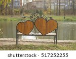 Small photo of Bench-hearts with forged elements in the park