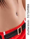 Small photo of Female abdomen with piercing in belly button