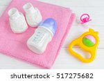 baby bottle with milk and towel ... | Shutterstock . vector #517275682