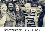 group of women socialize... | Shutterstock . vector #517311652