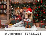 christmas photo of surprised... | Shutterstock . vector #517331215