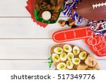 snacks for watching a football... | Shutterstock . vector #517349776