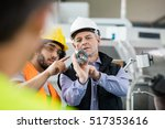 supervisor and manual worker... | Shutterstock . vector #517353616