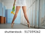 feet of the ballerina in a... | Shutterstock . vector #517359262