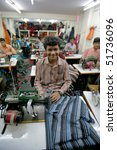 India   Feb 26  Textile Worker...