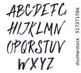 hand drawn brush font.... | Shutterstock .eps vector #517371586