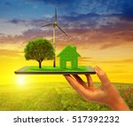 eco land on tablet computer at... | Shutterstock . vector #517392232