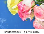 roses reflected in pure water  | Shutterstock . vector #517411882