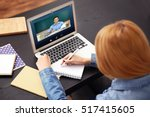 woman video conferencing with... | Shutterstock . vector #517415605