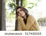 beautiful girl walks in autumn... | Shutterstock . vector #517430335