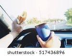 man is dangerously eating hot... | Shutterstock . vector #517436896