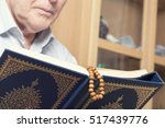 an old man hands holding the... | Shutterstock . vector #517439776
