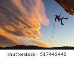 female climber rappelling down... | Shutterstock . vector #517443442