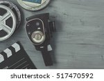 old movie camera with film... | Shutterstock . vector #517470592
