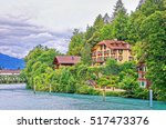 chalets at interlaken and... | Shutterstock . vector #517473376
