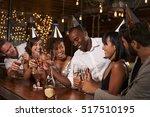 friends in party hats...   Shutterstock . vector #517510195