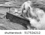 wave crashing over a breakwater ... | Shutterstock . vector #517526212