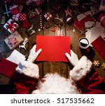 santa claus with gifts and red... | Shutterstock . vector #517535662