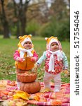 children twins are in a basket... | Shutterstock . vector #517554046