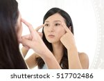 young woman having skin problems | Shutterstock . vector #517702486