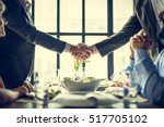 business people shaking hands... | Shutterstock . vector #517705102