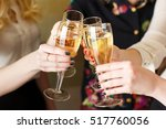 hands holding the glasses of... | Shutterstock . vector #517760056