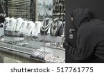 man wearing a mask robbed a...   Shutterstock . vector #517761775