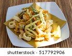 mixed fried fish | Shutterstock . vector #517792906