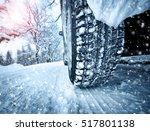 car tires on winter road...   Shutterstock . vector #517801138