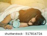 sad asian woman trying to sleep ...   Shutterstock . vector #517816726