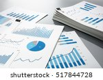 preparing report. blue graphs... | Shutterstock . vector #517844728