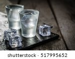 Small photo of Vodka in shot glasses on rustic wood background
