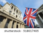 British Union Jack flag flying in front of the Bank of England in the City of London financial center