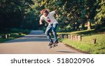 action shot of a skateboarder... | Shutterstock . vector #518020906