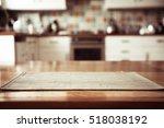Stock photo blurred kitchen interior and napkin and desk space 518038192