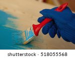 hand in blue gloves painting... | Shutterstock . vector #518055568