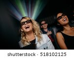 smiling female friends watching ... | Shutterstock . vector #518102125