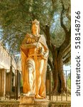 Small photo of The sculpture of King Alfonso XI wise at the entrance to the Alcazar. Cordoba. Andalusia.