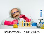 Small photo of Mad Scientist mixing a formula.